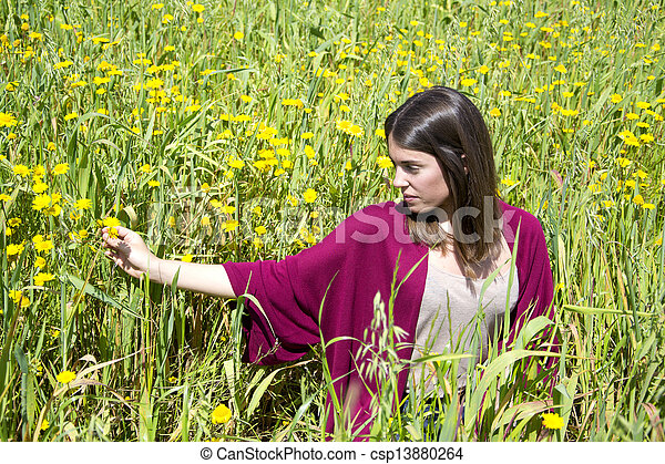Young woman on a field of flowers - csp13880264