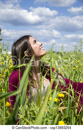 Young woman on a field of flowers - csp13893254