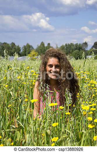 Young woman on a field of flowers - csp13880926