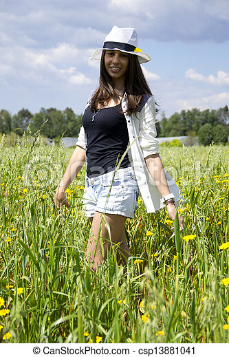 Young woman on a field of flowers - csp13881041