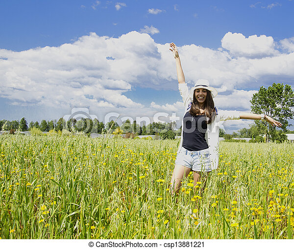 Young woman on a field of flowers - csp13881221