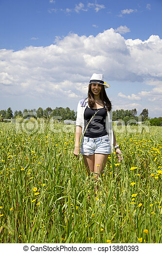 Young woman on a field of flowers - csp13880393