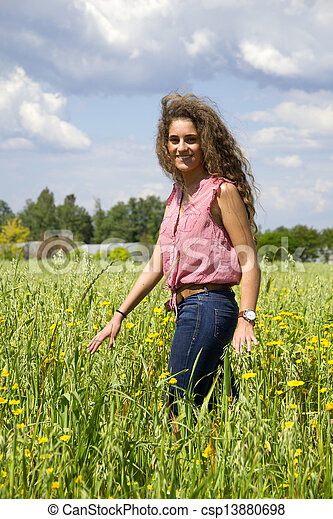 Young woman on a field of flowers - csp13880698