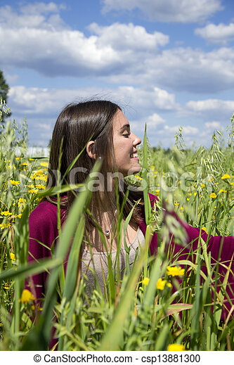 Young woman on a field of flowers - csp13881300