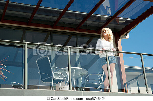 young woman on balcony - csp5745424