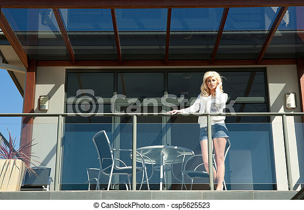young woman on balcony - csp5625523