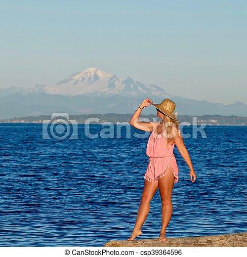 young woman on bech by ocean centennial beach in boundary bay