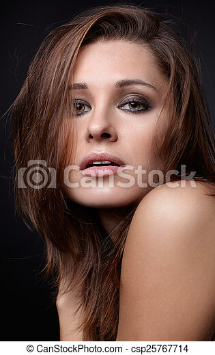 Young woman on black  - csp25767714