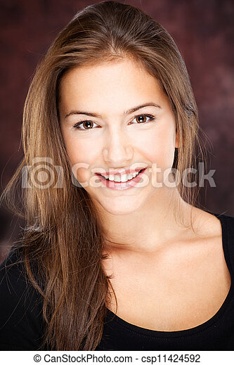 young woman on dark background - csp11424592