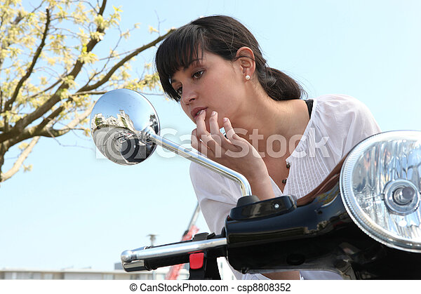 young woman on scooter - csp8808352