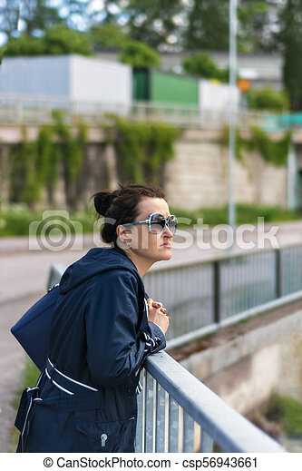Young woman on the waterfront. - csp56943661