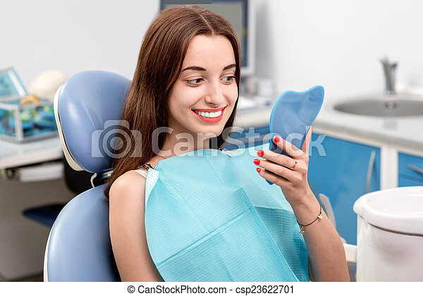 Young woman patient visiting dentist in the dental office - csp23622701
