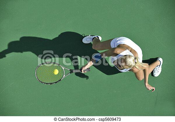 young woman play tennis outdoor - csp5609473