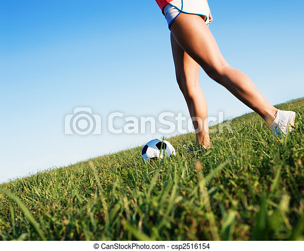 Young Woman Playing Soccer - csp2516154