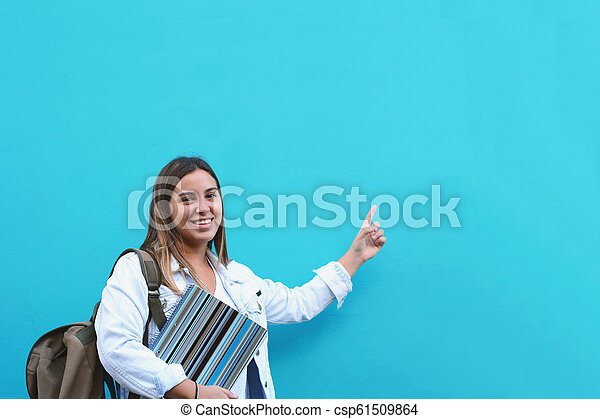 Young woman pointing at copy space - csp61509864