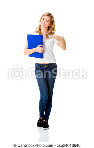 Young woman pointing on her binder - csp24018646