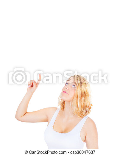 Young woman pointing up, copy space - csp36047637