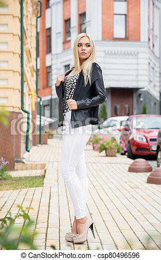 Young woman posing on the street - csp80496596