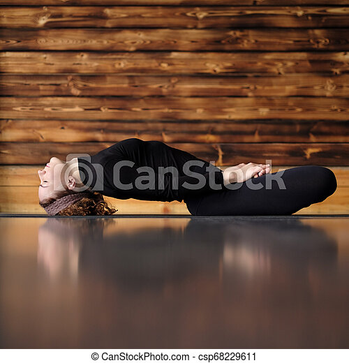 beautiful sporty young woman practices yoga asana