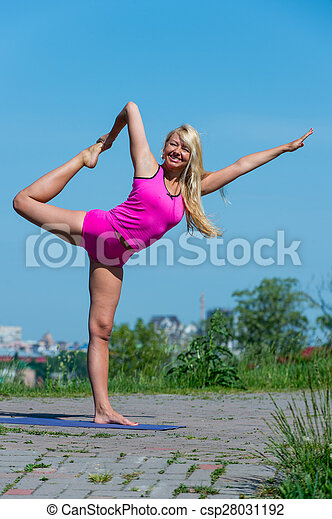 young woman practicing yoga in nature preatty young woman