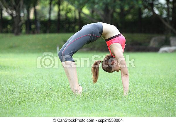 young woman practicing yoga  urdhva dhanurasana  upward