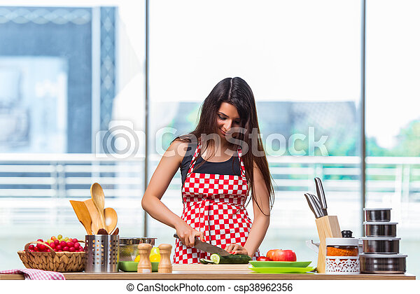 Young woman preparing salad in the kitchen - csp38962356