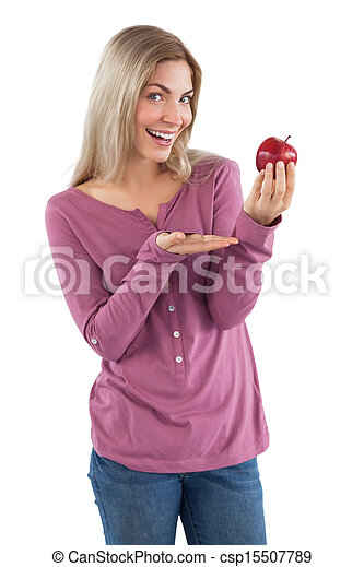 Young woman presenting an apple - csp15507789