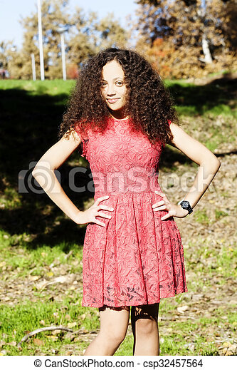 Young Woman Red Dress Standing Outside On Grass - csp32457564