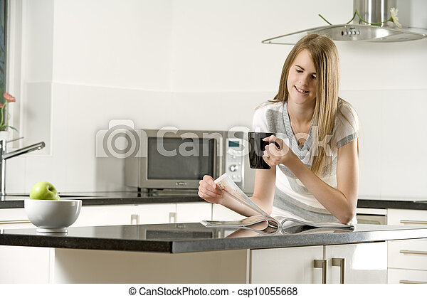 Young woman relaxing in her kitchen - csp10055668