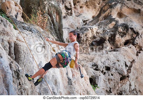 Young woman rock climbing on white mountain - csp50729514