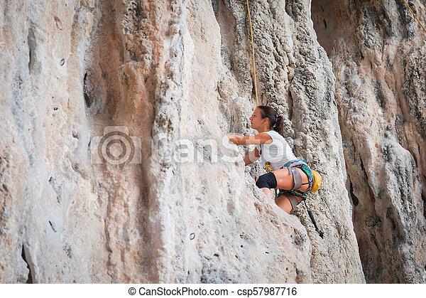 Young woman rock climbing on white mountain - csp57987716