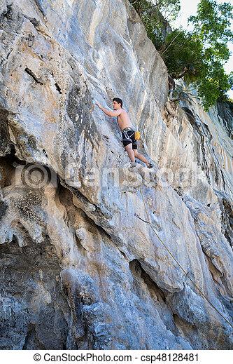 Young woman rock climbing on white mountain - csp48128481