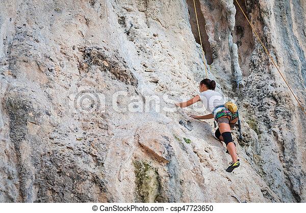 Young woman rock climbing on white mountain - csp47723650