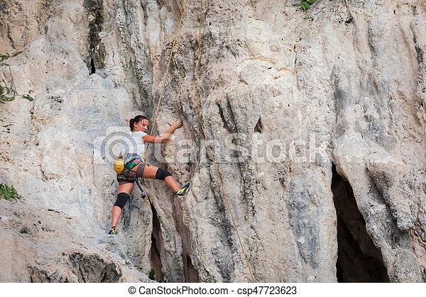 Young woman rock climbing on white mountain - csp47723623