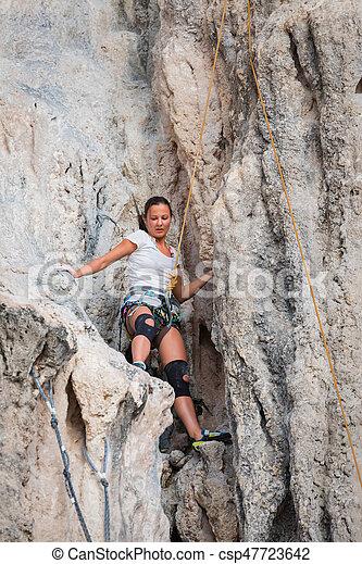 Young woman rock climbing on white mountain - csp47723642