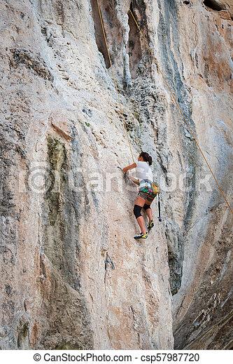 Young woman rock climbing on white mountain - csp57987720