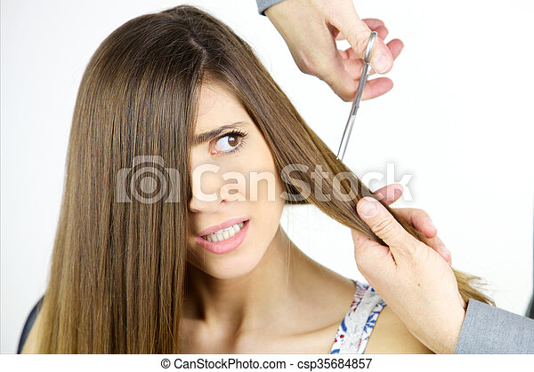 Young Woman Scared Of Getting Long Hair Cut With Scissors Isolated
