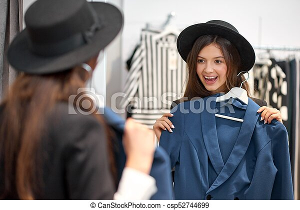 c1fe6ca7ae4 Young woman shopping for clothes. Shot of an attractive happy young ...