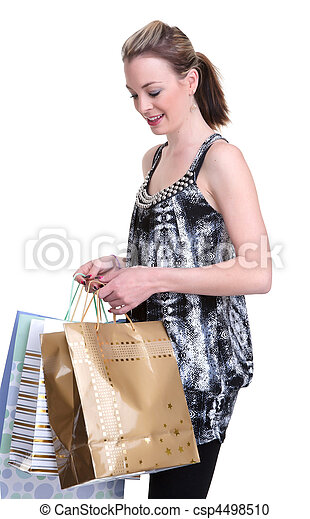 young woman shopping on white - csp4498510