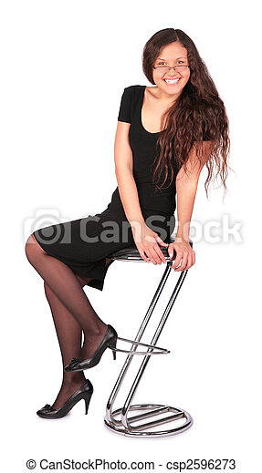 young woman sit on the bar stool - csp2596273