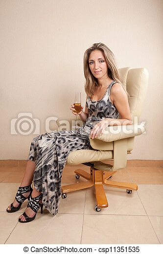 Young Woman Sitting In Chair - csp11351535