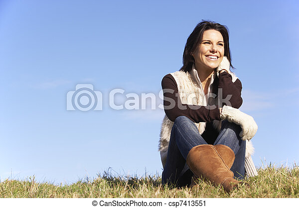 Young Woman Sitting In Park - csp7413551
