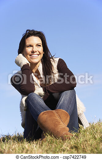 Young Woman Sitting In Park - csp7422749