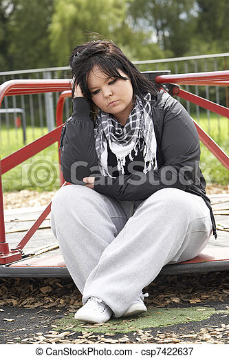 Young Woman Sitting In Playground - csp7422637