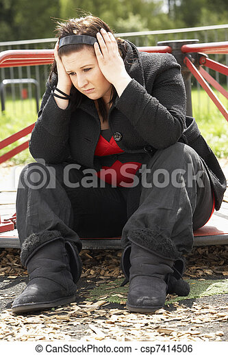 Young Woman Sitting In Playground - csp7414506