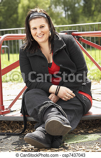 Young Woman Sitting In Playground - csp7437043