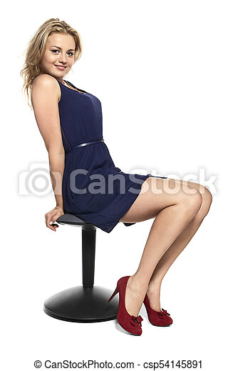 Young Woman Sitting on Stool - csp54145891