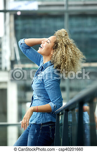 Young woman smiling with hand in hair - csp40201660
