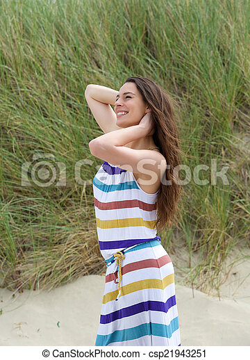 Young woman smiling with hand in hair - csp21943251