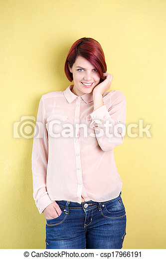 Young woman smiling with hand in hair - csp17966191
